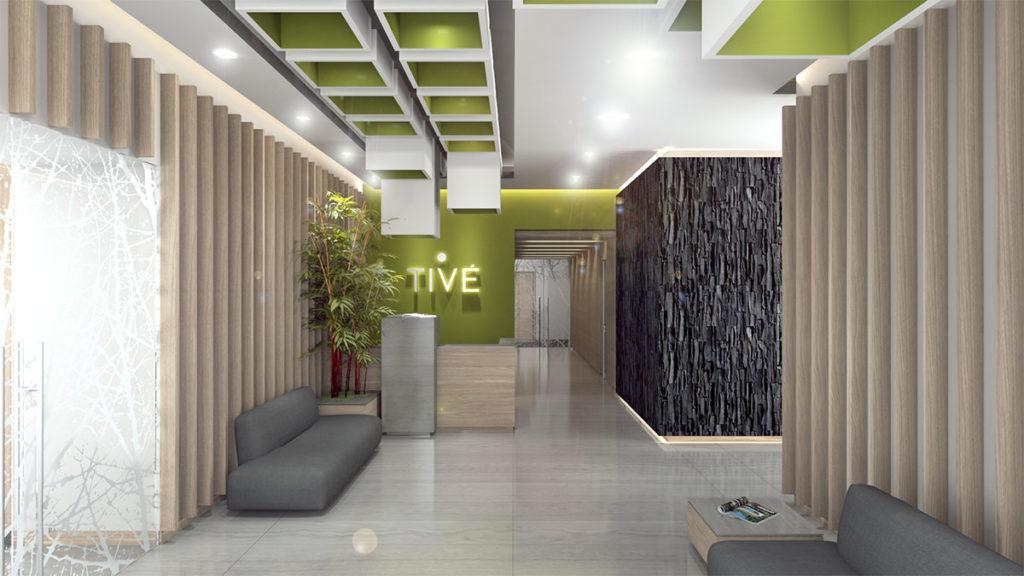 Proyecto integral de interiorismo del edificio residencial Tivé en Bosque del Real realizado por Manuel Torres Design donde podemos ver la entrada decorada en tonos verdes